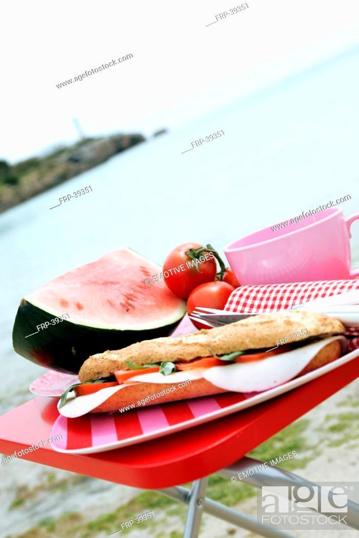 Stock Photo: Tomato-mozzarella sandwich, watermelon and tomatos on the beach.