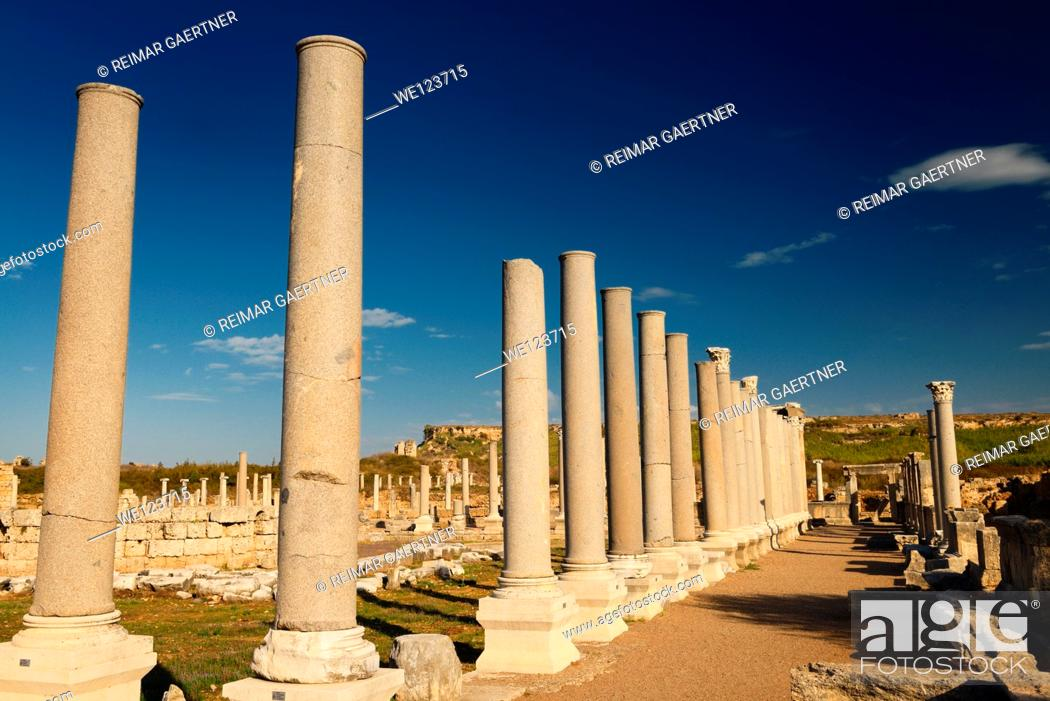 Stock Photo: View north to Perge Turkey Acropolis from colonade of pillars at Agora with circular temple.