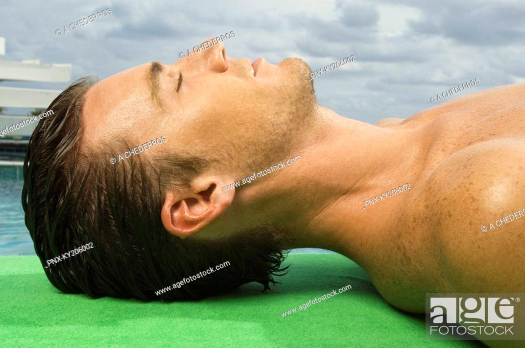 Stock Photo: Man resting at the poolside.