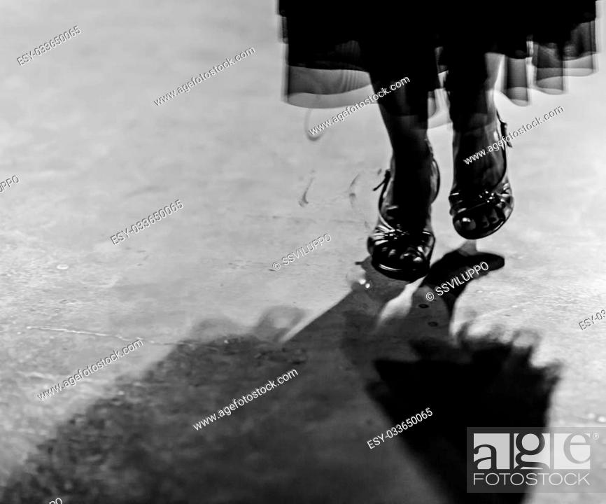 Stock Photo: Detail of shoes with shadows in milonga ballroom.