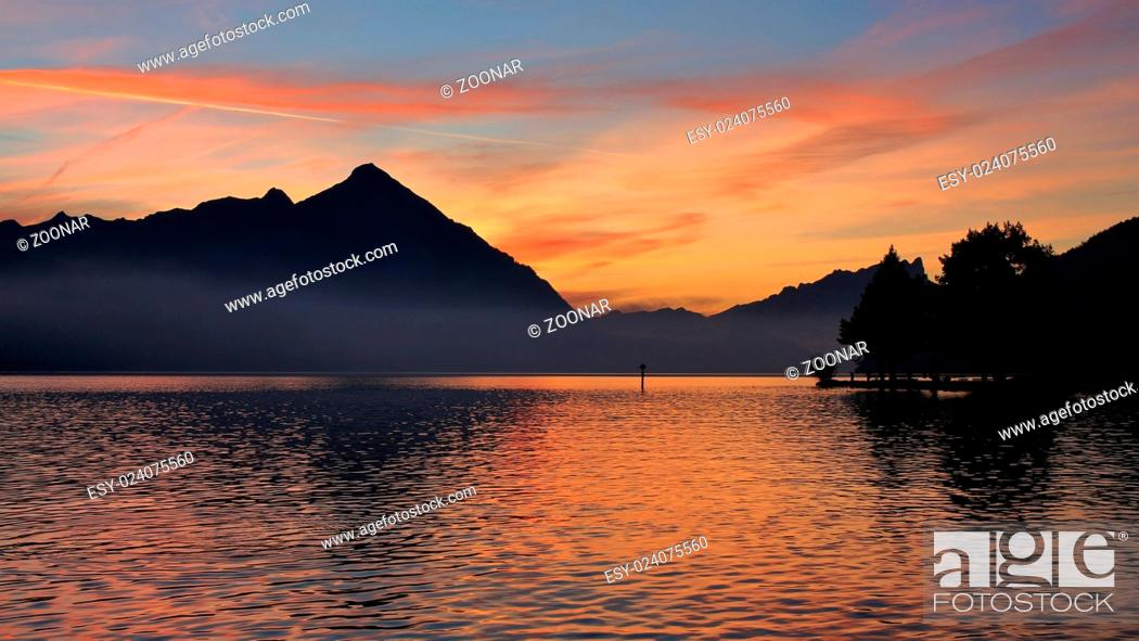 Stock Photo: Colorful evening sky over Mt Niesen and lake Thun.