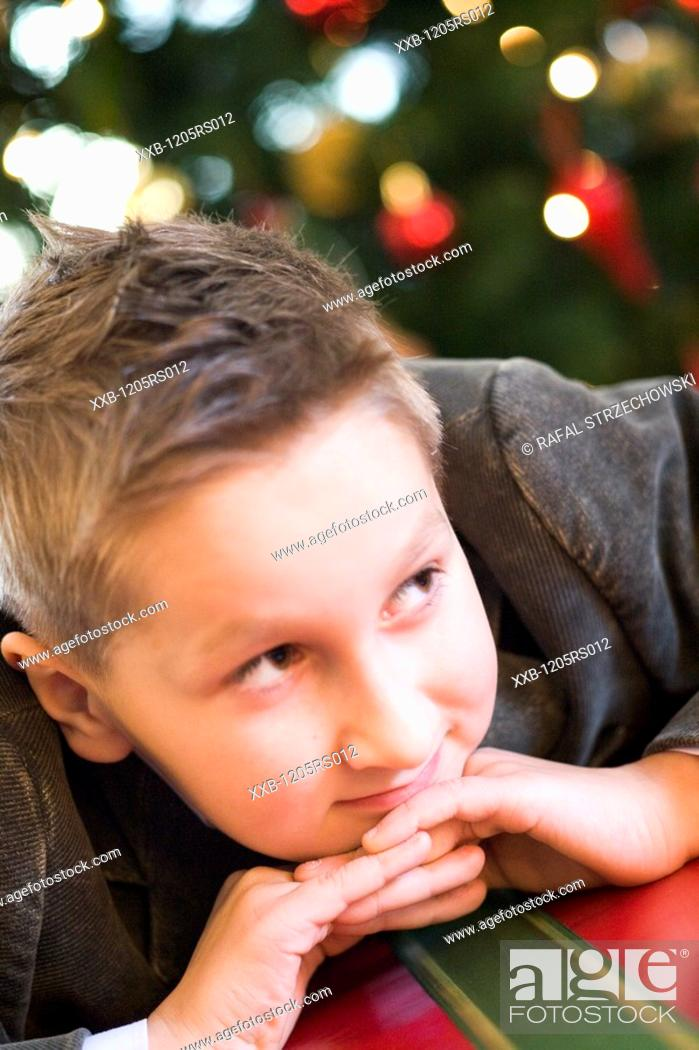 Stock Photo: boy with a christams gift.