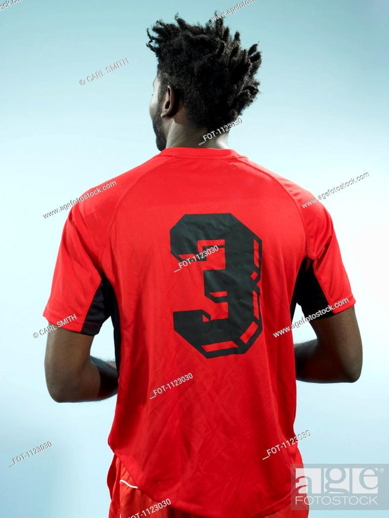 Stock Photo: A man wearing a numbered soccer shirt.