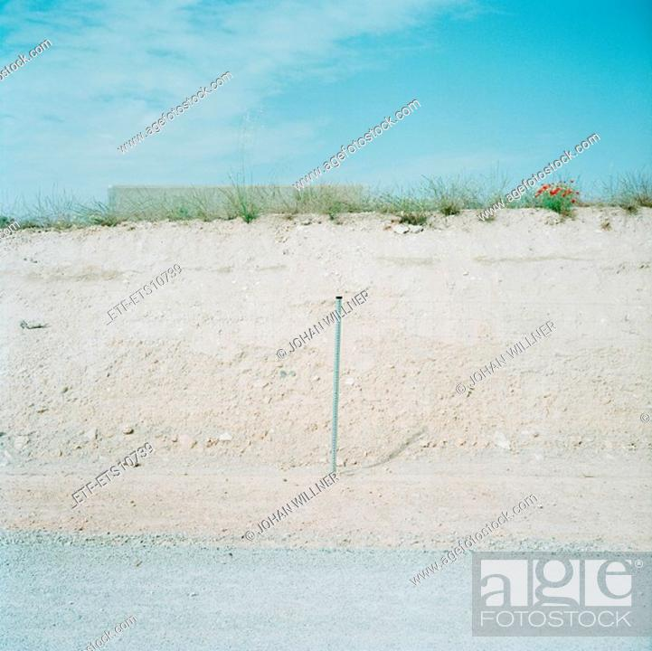 Stock Photo: A fence by a road.