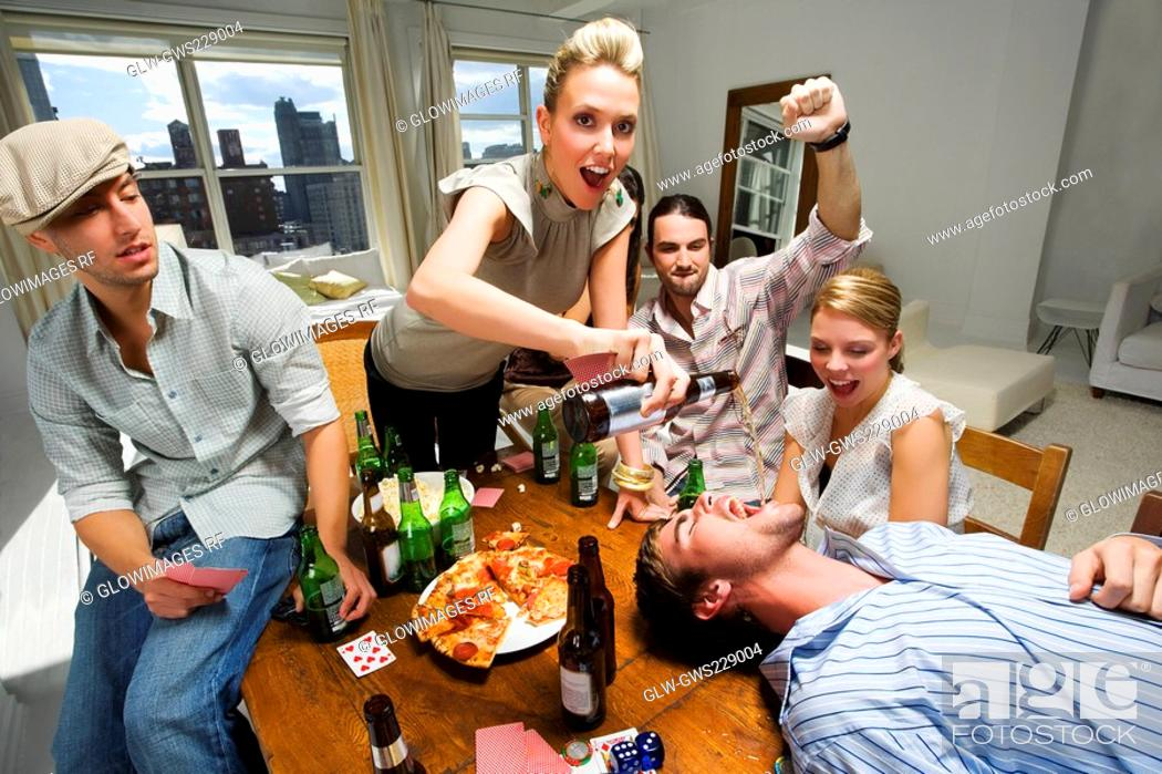 Stock Photo: Young woman with her friends enjoying a party.