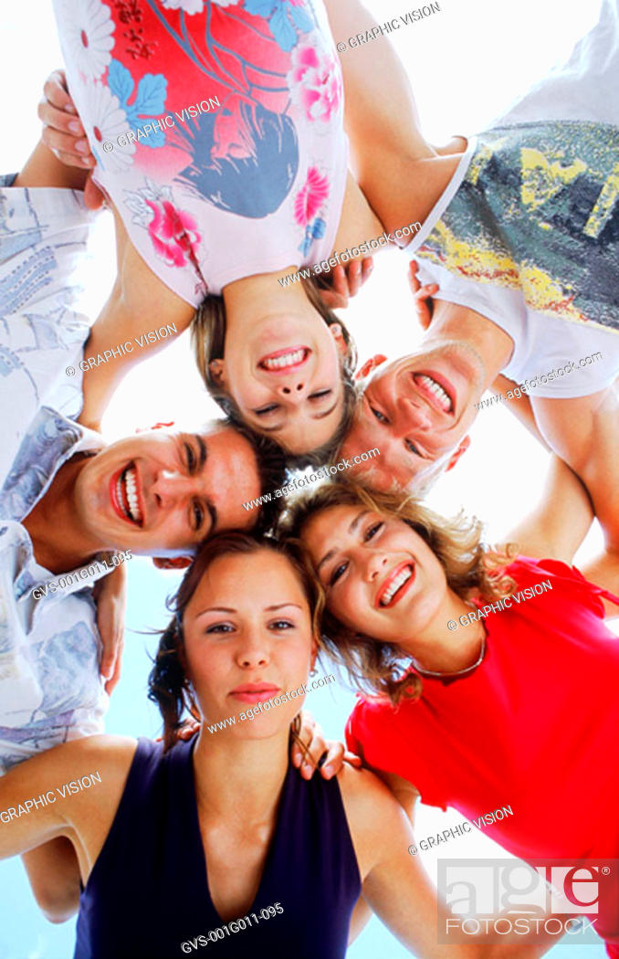 Stock Photo: Low angle view of men and women in a huddle.