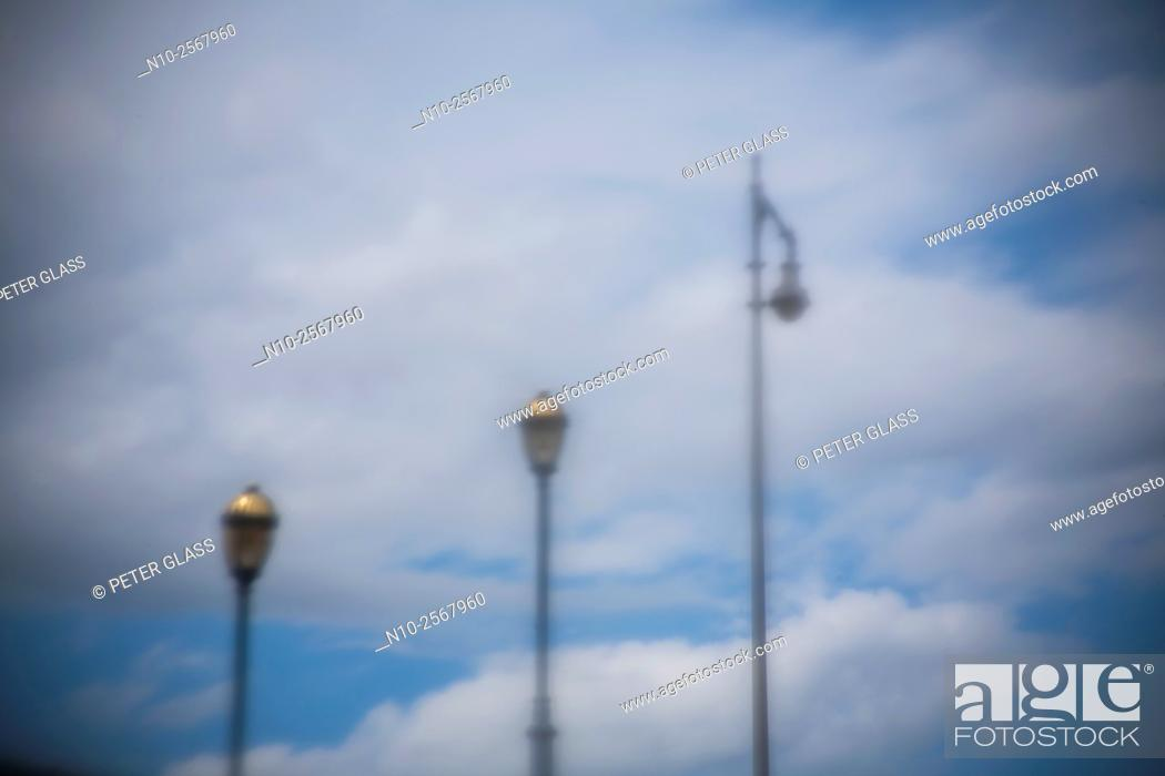 Stock Photo: Streetlights on a cloudy day.