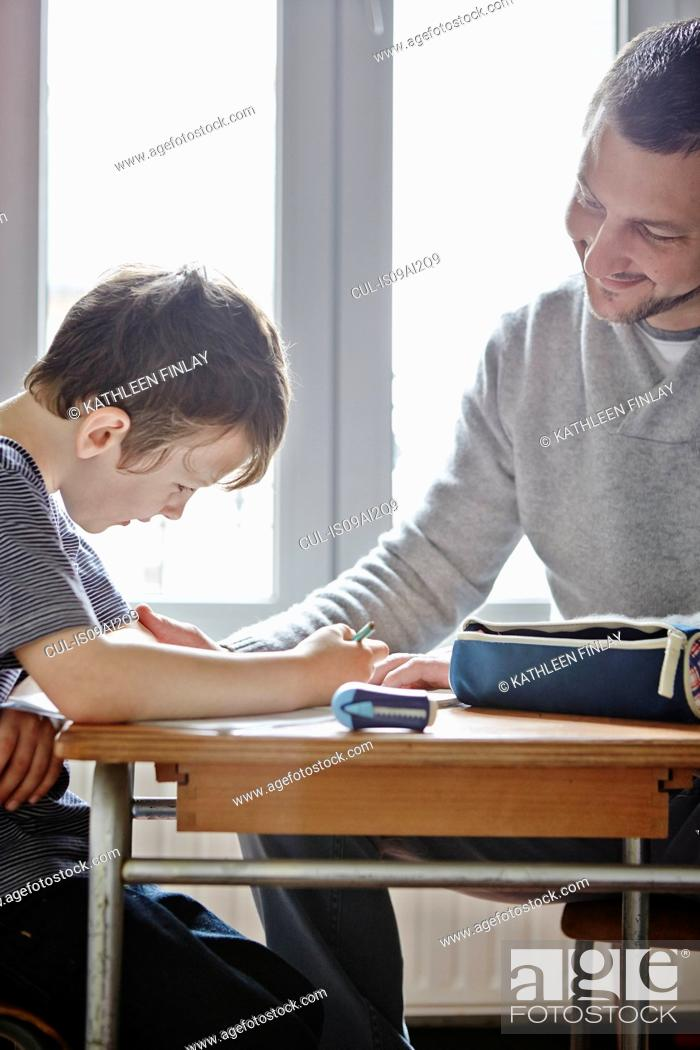 Stock Photo: Father helping son with homework.