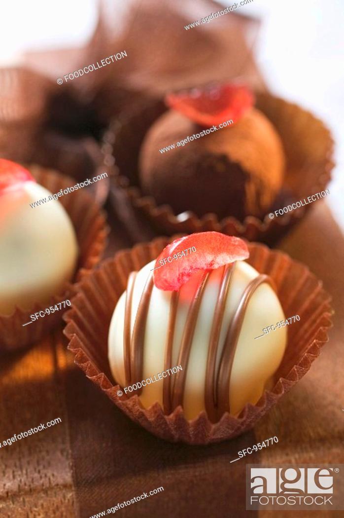 Stock Photo: Chocolates on gift box close-up.
