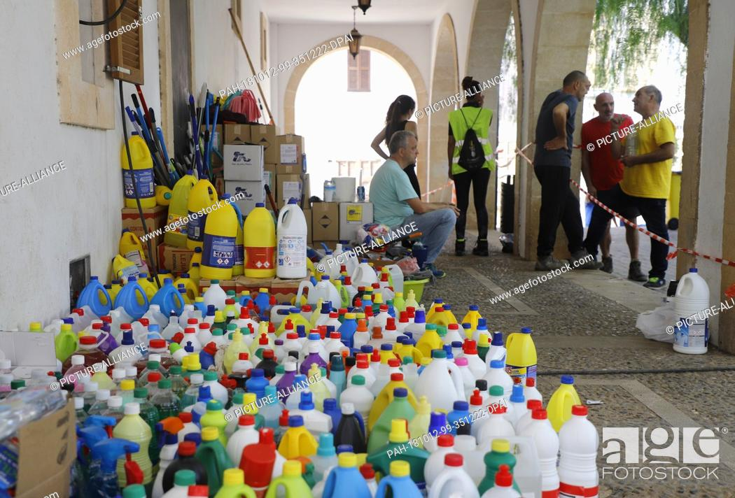 Stock Photo: 12 October 2018, Spain, Sant Llorenc: Volunteers providing food and cleaners to help those affected by the storm three days after the flood disaster.