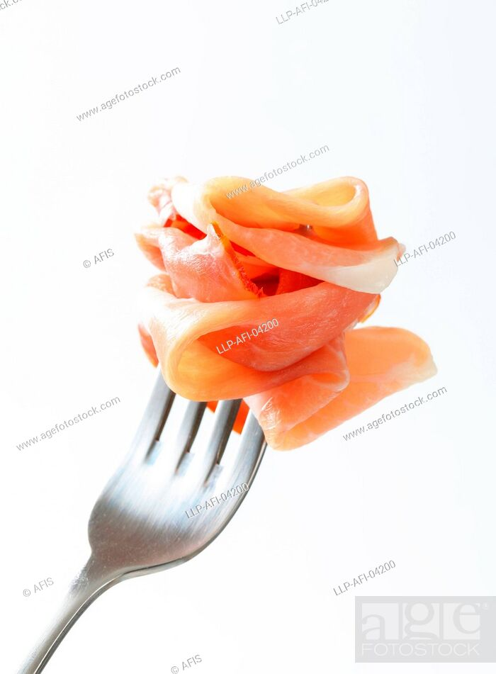 Stock Photo: Prosciutto on a fork.