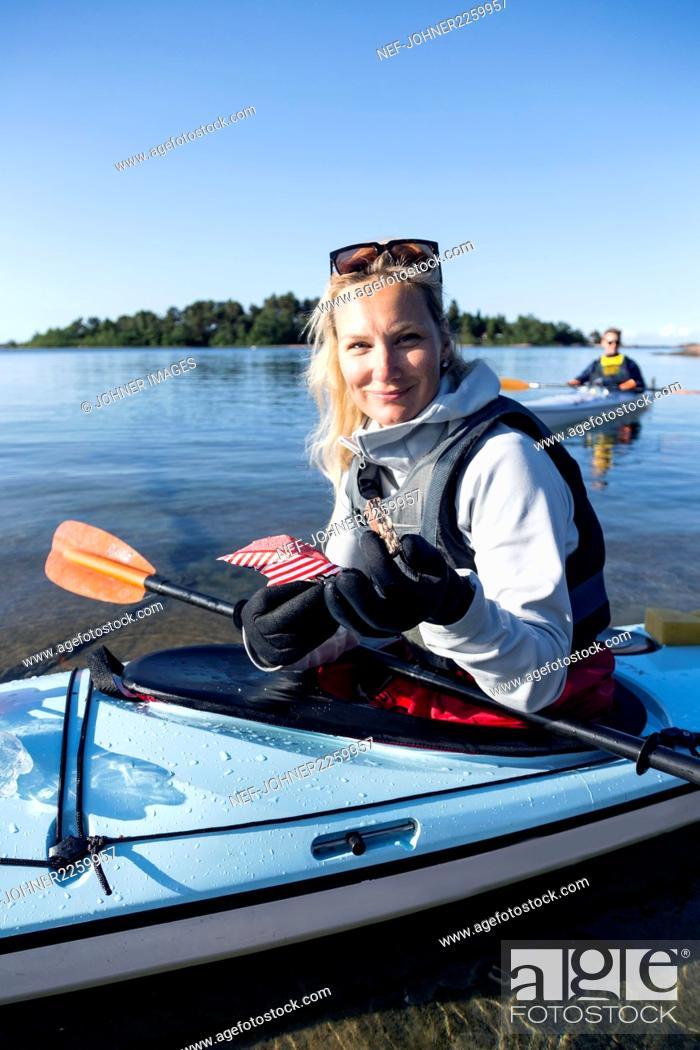 Photo de stock: Woman kayaking on sea.
