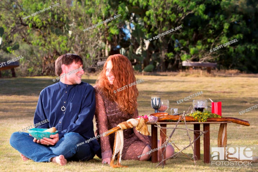 Stock Photo: Happy pagan couple at altar with woodland pentagram.