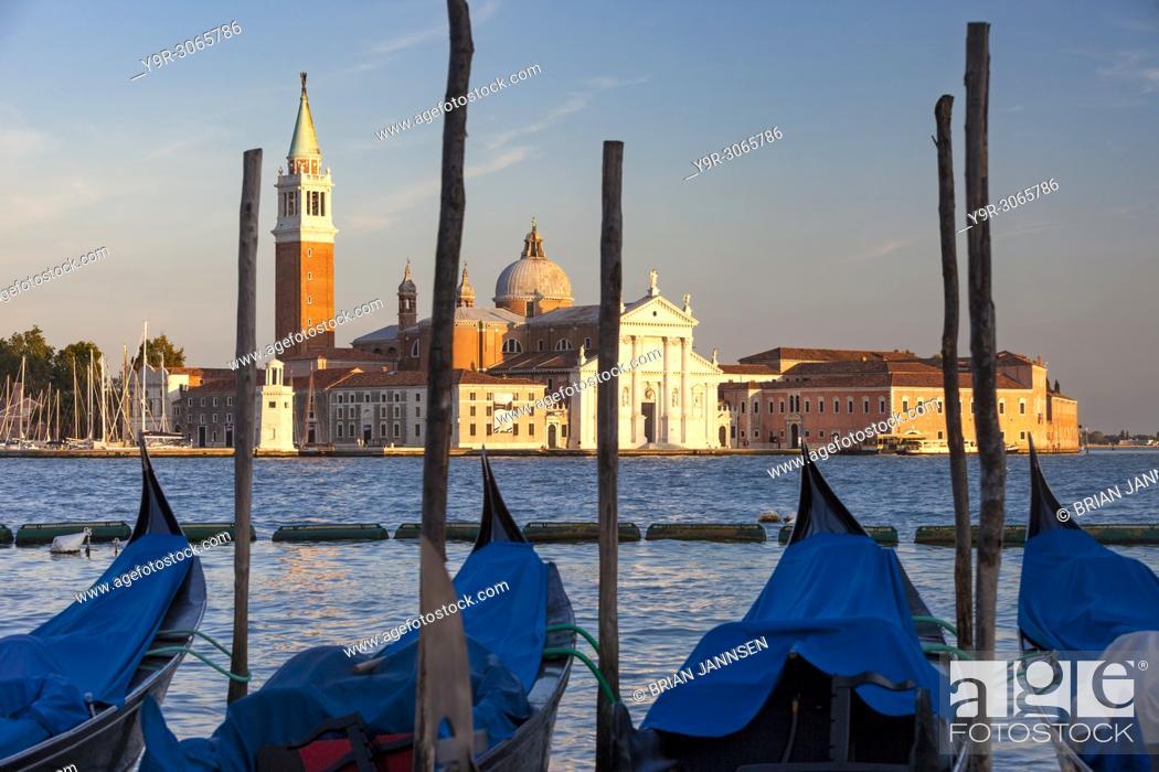 Stock Photo: Gondolas moored across the canal from San Giorgio Maggiore, Venice, Veneto, Italy.