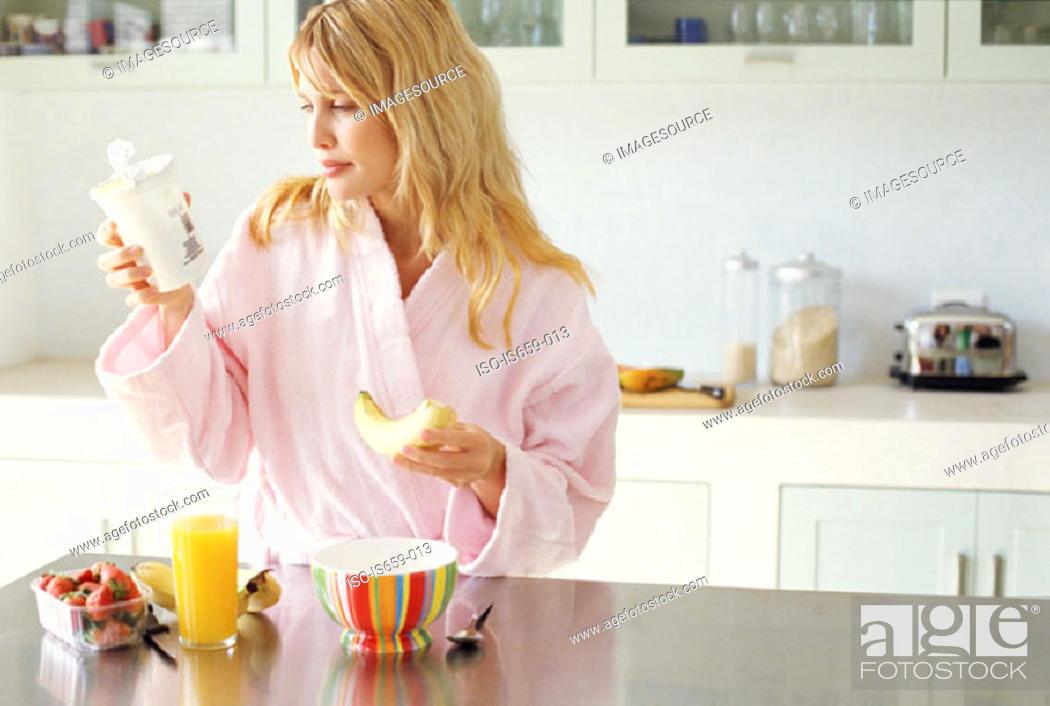 Stock Photo: Woman having a healthy breakfast.