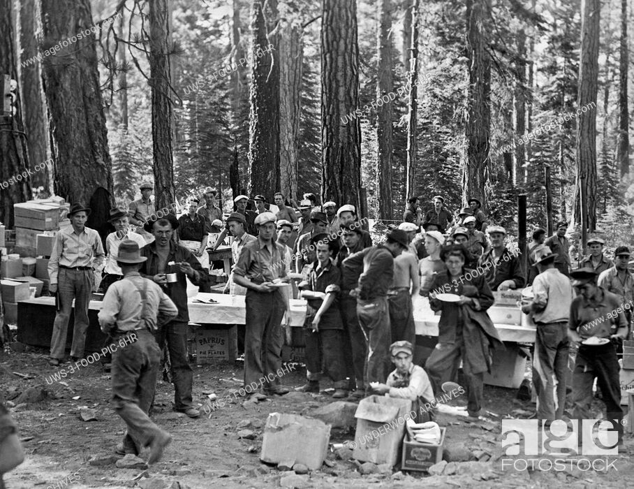 Stock Photo: Eagle Lake, Oregon: c. 1940.The logging crew at Eagle Lake take a meal break.