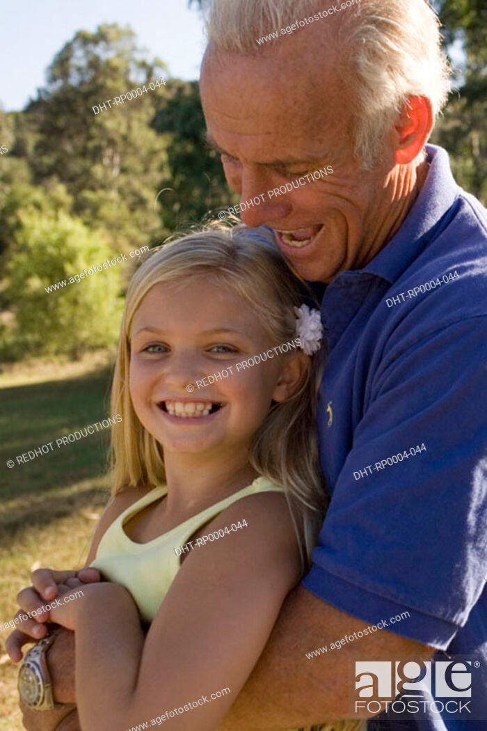 Stock Photo: Grandfather and granddaughter in park.