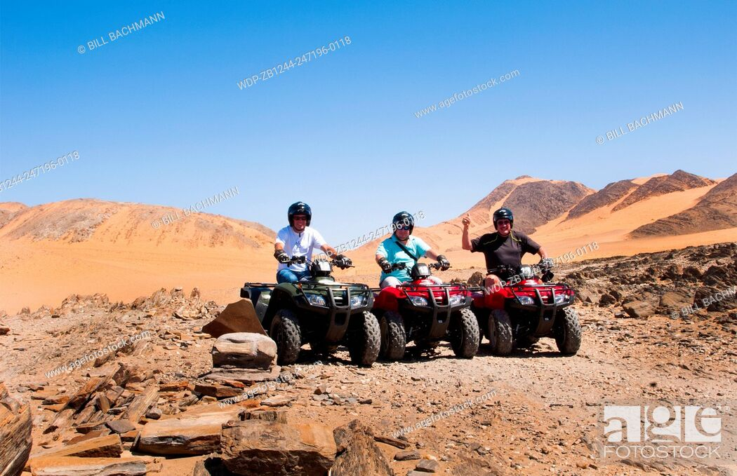 Imagen: Namibia Northern Desert of Namib Desert tourists 4 wheeling on sand dunes of Hartmann Berge deserted land Hartmann Valley Marienflub.