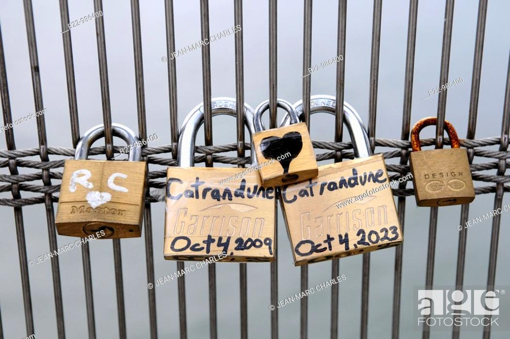 Stock Photo: Padlocks of love, passererelle Léopold Sedar Senghor, Paris, France.