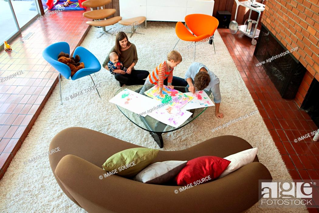 Stock Photo: Family playing in living room.