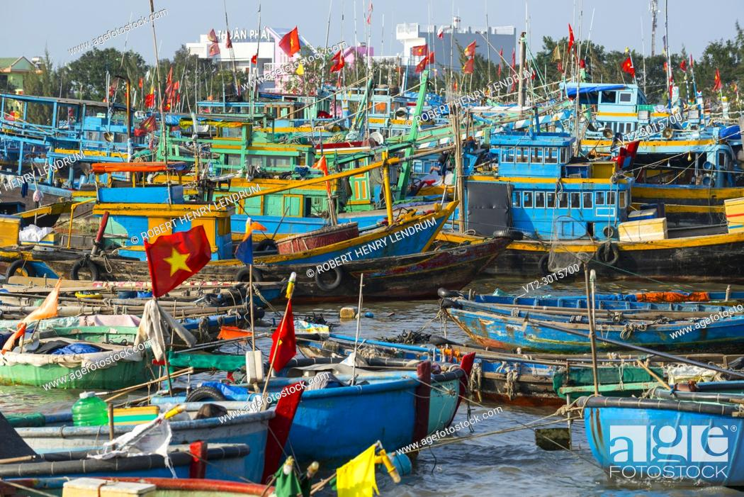 Stock Photo: Traditional wooden fishing boats in the port city of PhanThiet, Vietnam.