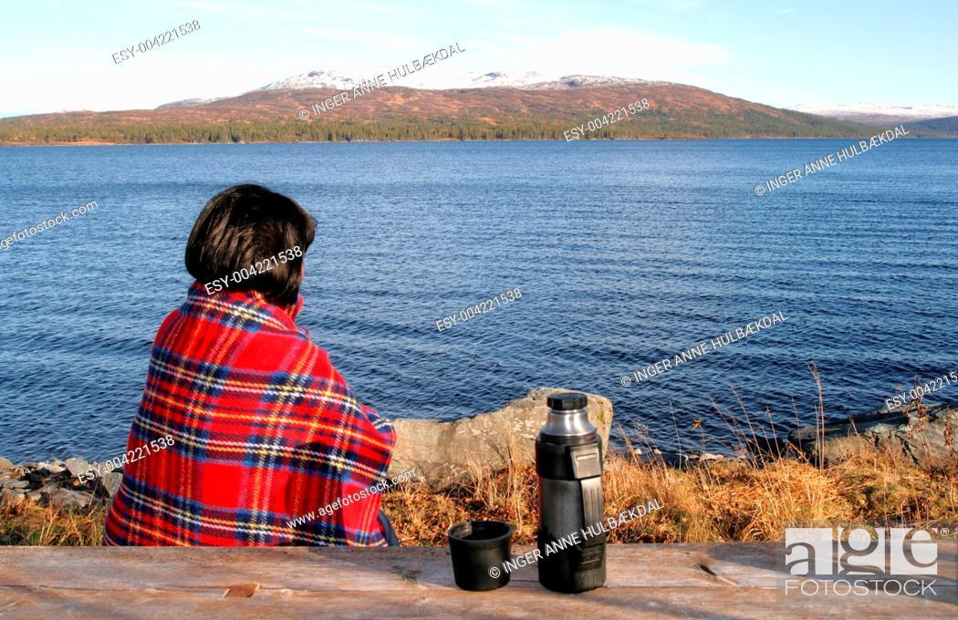 Stock Photo: Woman by a lake.