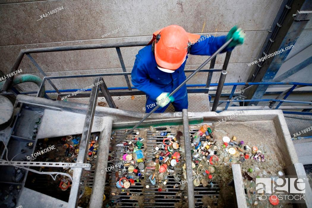 Stock Photo: Recycling of bottle caps All municipalities in The Netherlands are required to provide known collection points for recyclable and/or hazardous materials All.
