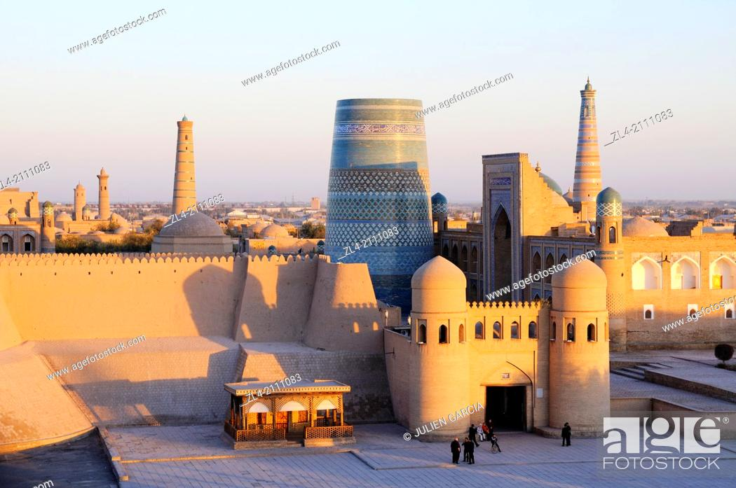 Stock Photo: Walled city of Khiva viewed from the West Gate in the evening. Uzbekistan, Khorezm, Khiva, Itchan Kala (inner town).