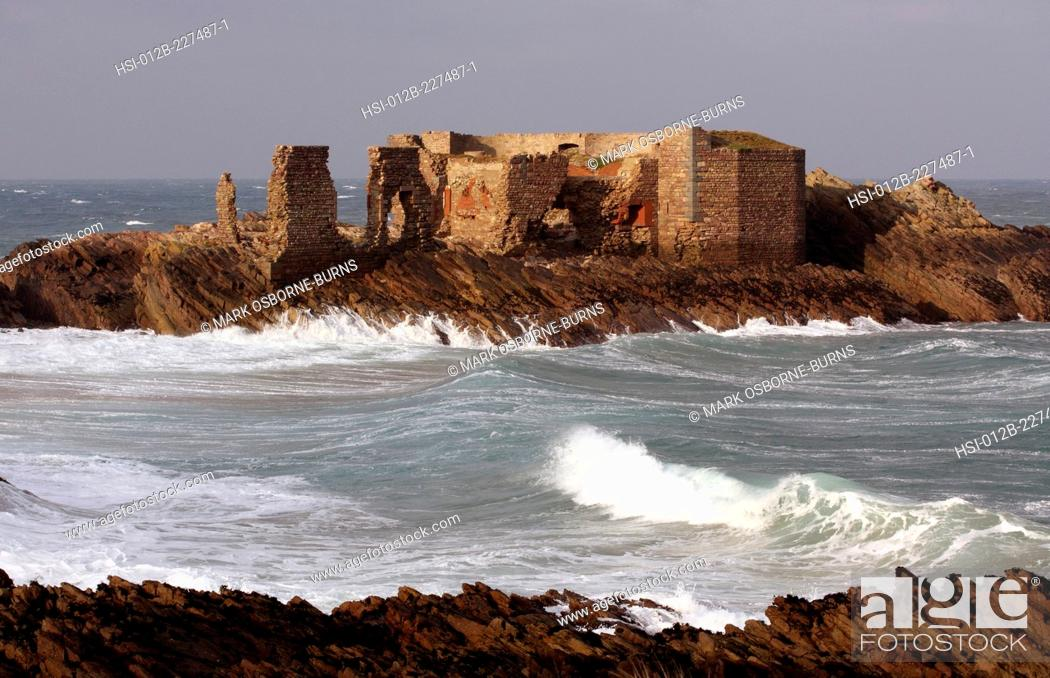 Stock Photo: British Channel Islands. Alderney. View of coastal ruin of Victorian Fort Les Hommeaux Florains.