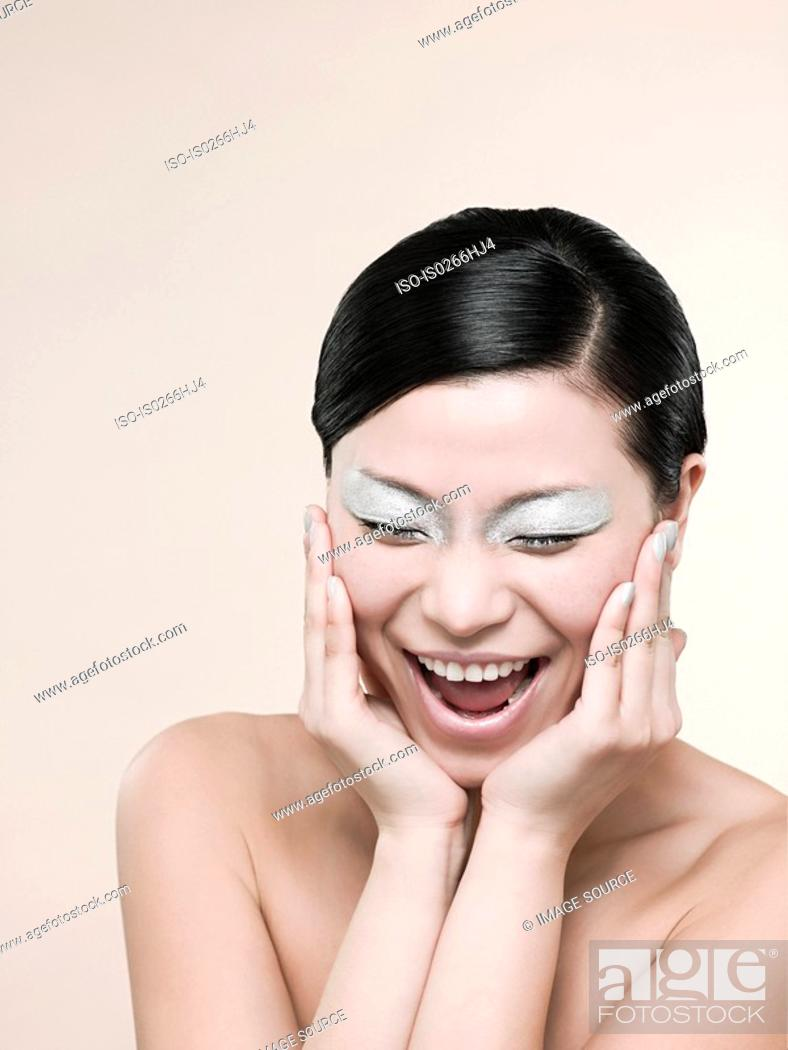 Stock Photo: A young woman laughing.