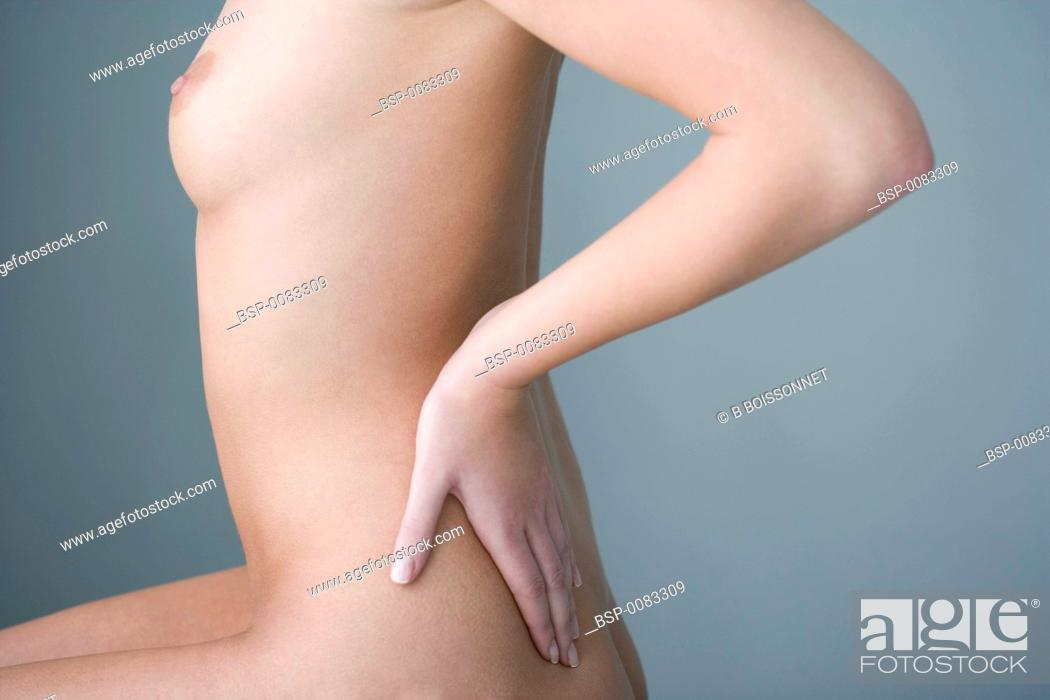 Stock Photo: LOWER BACK PAIN IN A WOMAN Model.