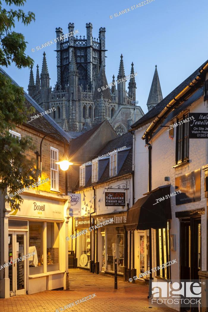 Stock Photo: Night falls in Ely, Cambridgeshire, England. The Cathedral looms in the distance.