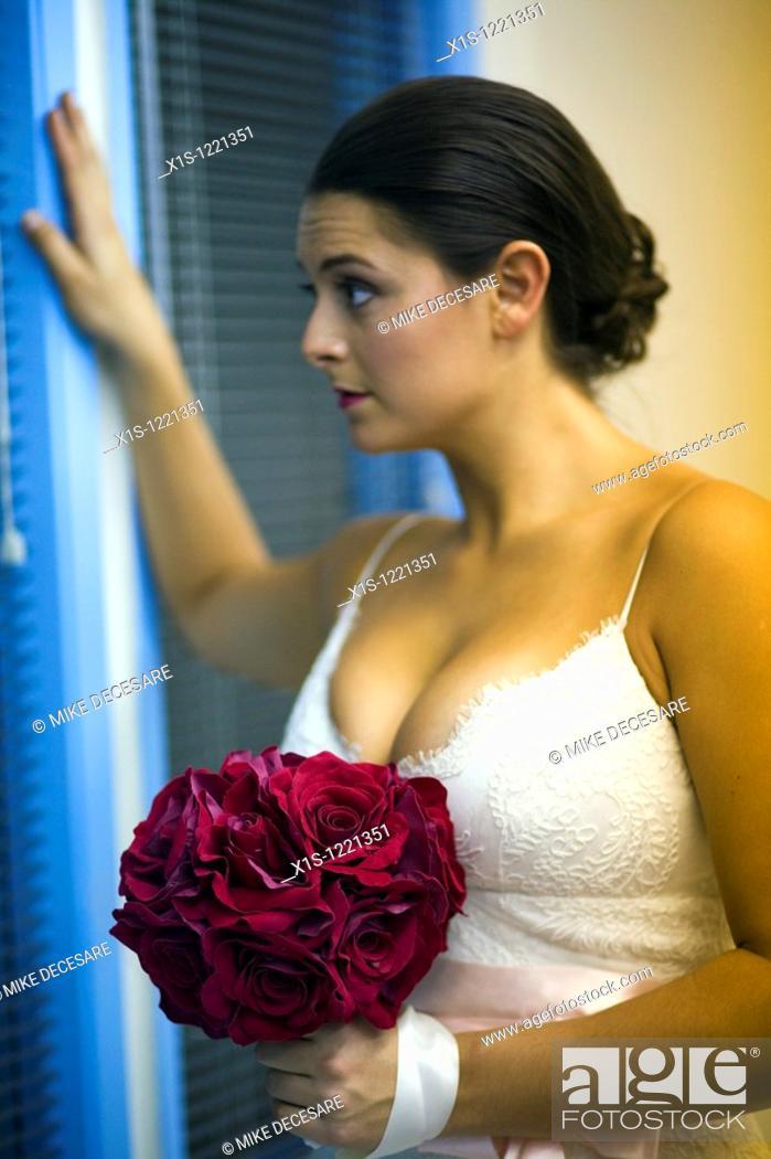 Stock Photo: Model posing in white satin wedding gown.