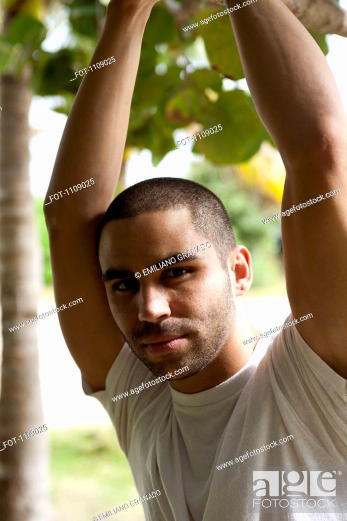 Stock Photo: A handsome young man posing outdoors.