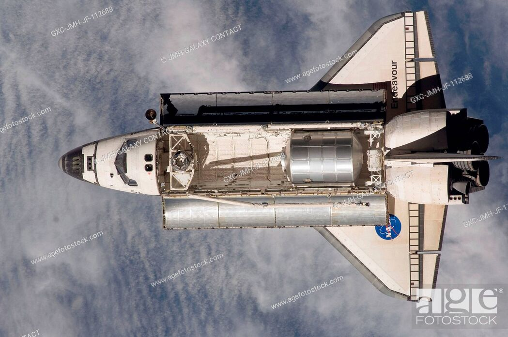 Stock Photo: Backdropped by a blue and white Earth, Space Shuttle Endeavour approaches the International Space Station during STS-126 rendezvous and docking operations.