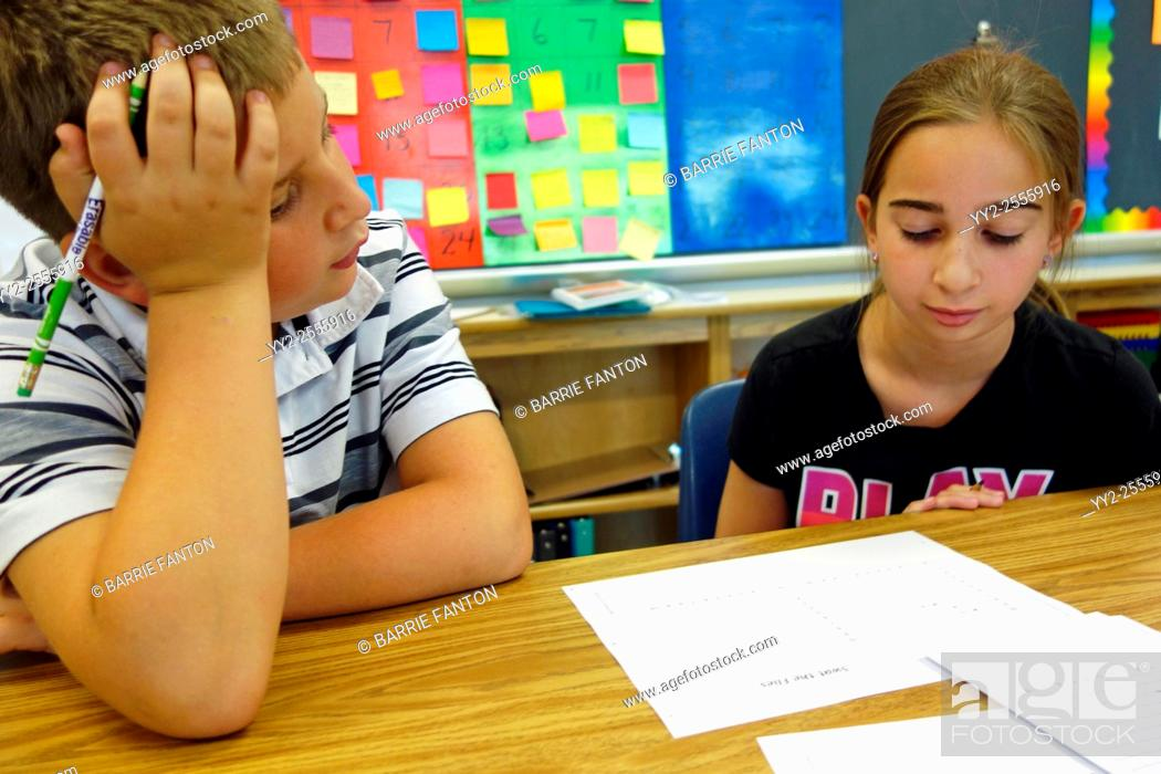 Stock Photo: 6th Grade Students Working Together in Math Class, Wellsville, New York, United States.