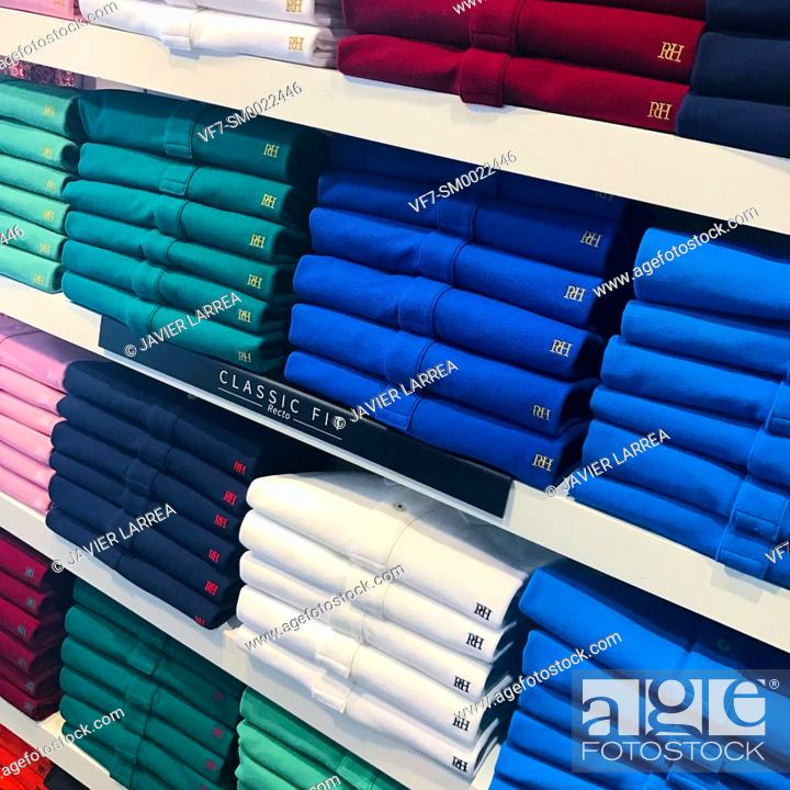 Stock Photo: Clothing store, shirts and polos in different colors,.