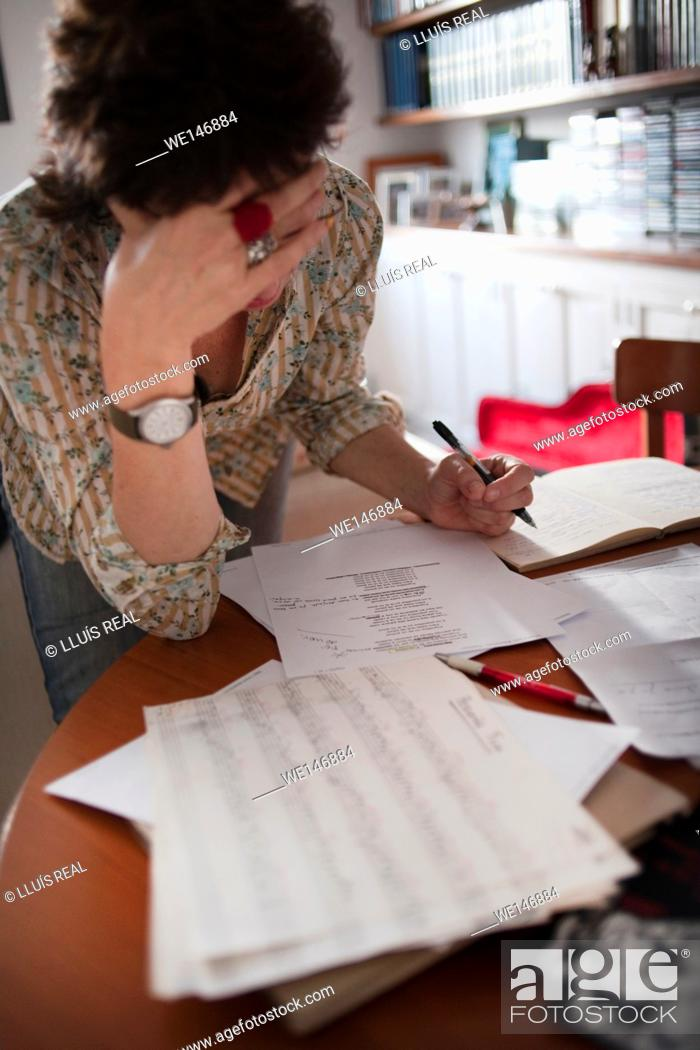 Stock Photo: a woman studying lyrics, in a music rehearsal.