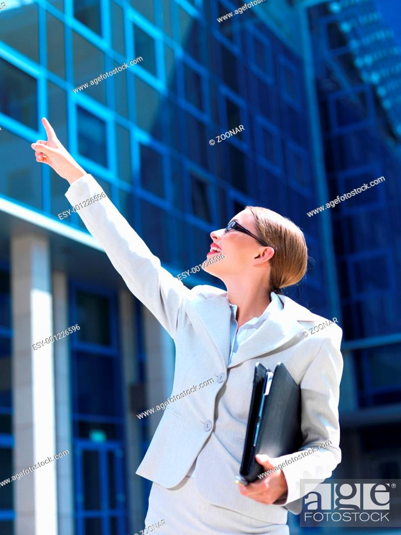 Stock Photo: Beautiful business woman standing outdoor modern building.