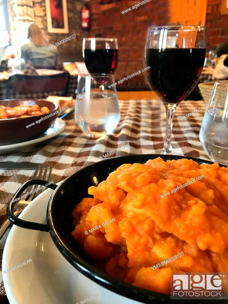 Stock Photo: Patatas revolconas serving in a traditional restaurant. Castilla Leon, Spain.