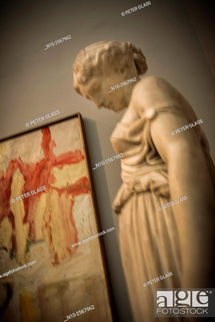 Stock Photo: Sculpture and painting in an art gallery.
