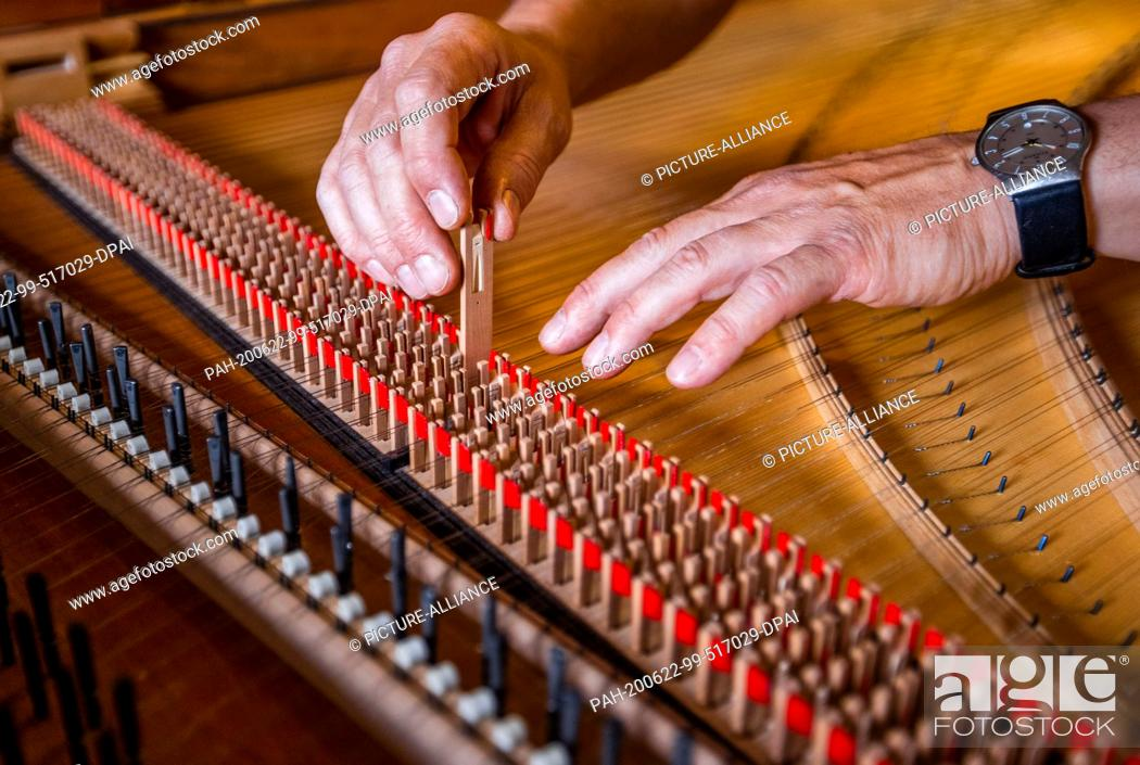 "Stock Photo: 22 June 2020, Mecklenburg-Western Pomerania, Rostock: Instrument maker Johann-Gottfried Schmidt uses the Springer in the workshop """"Historical Keyboard."