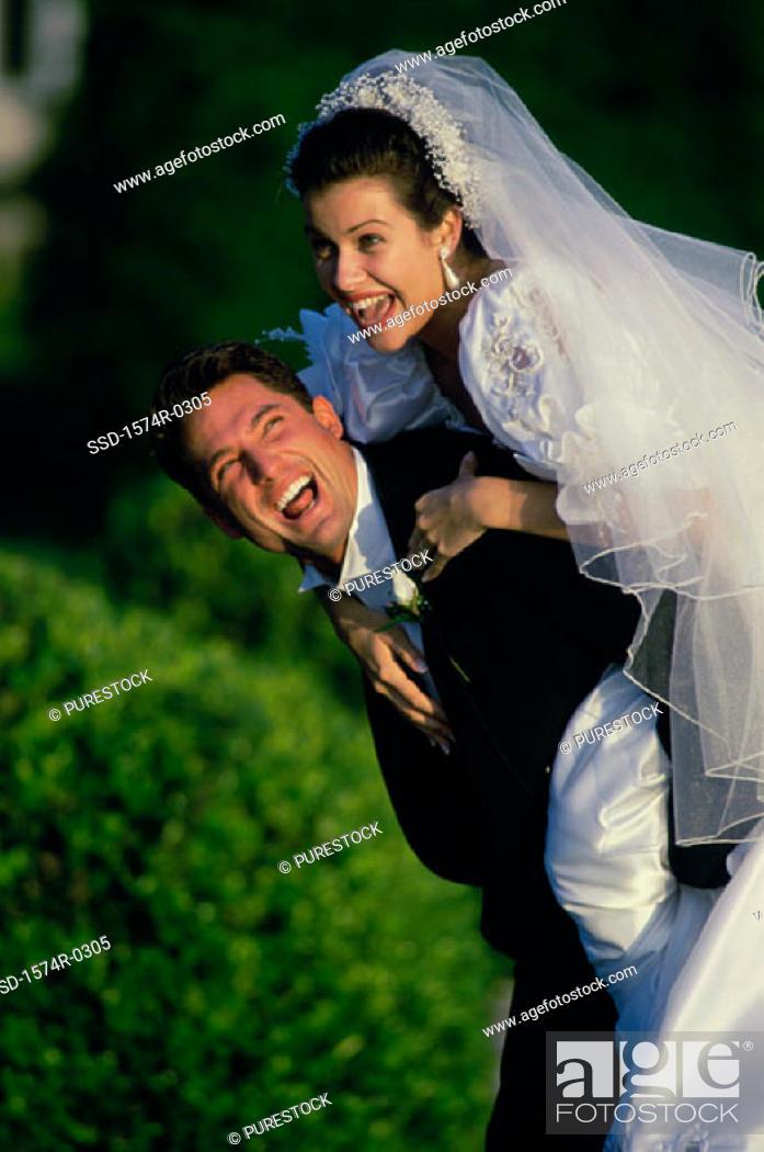 Stock Photo: Bride hugging her groom.