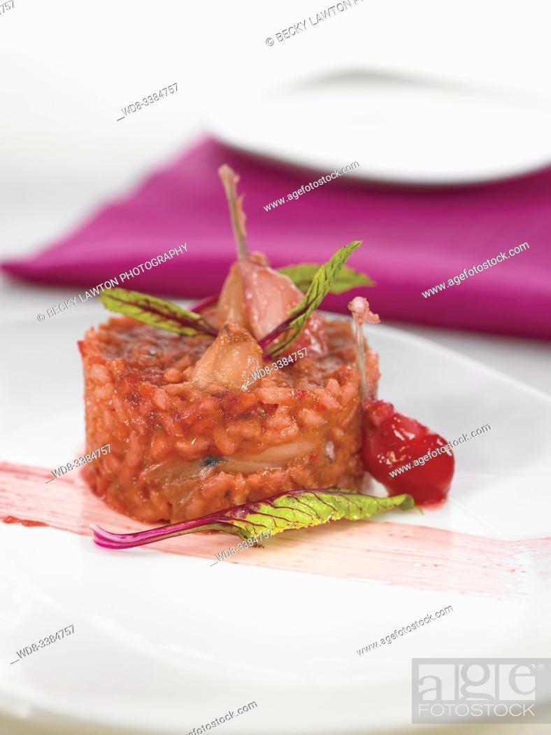Stock Photo: arroz cremoso de remolacha y ancas de rana / creamy beet rice and frog legs.