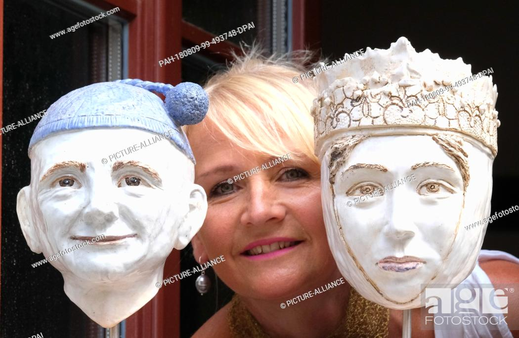 Stock Photo: 08 August 2018, Germany, Naumburg: Heike Minner stands between two of her sculptures in her house in the centre of Naumburg - the right one depicts Uta von.
