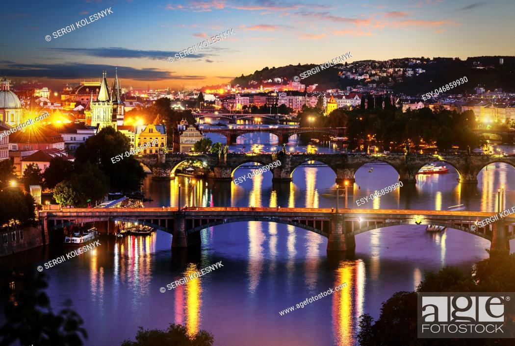 Stock Photo: View of illuminated bridges in Prague in evening.