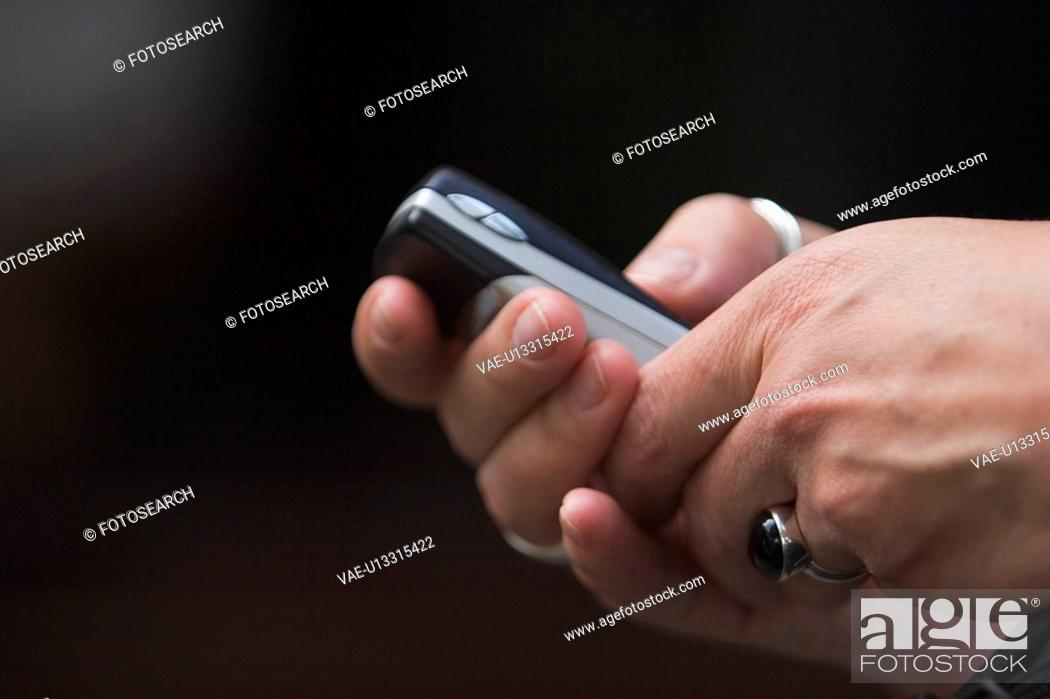Stock Photo: Holding, Mobile Phone, Close-Up.