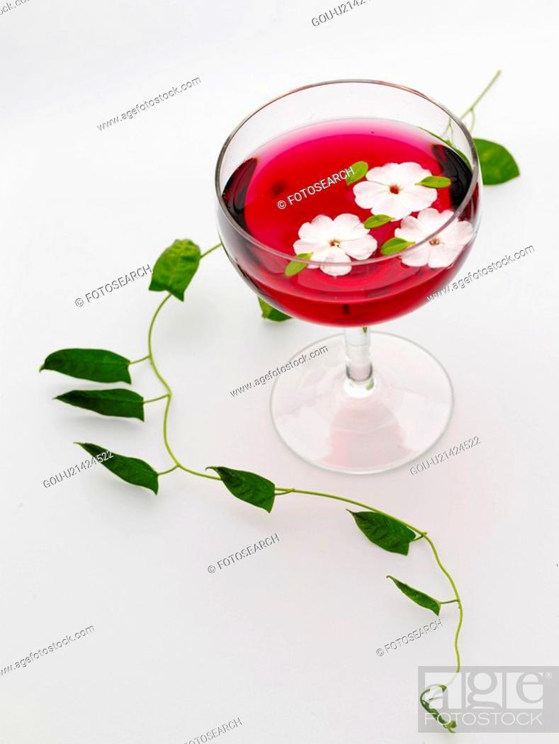 Stock Photo: beverage, house item, petal, drink, cocktail glass.
