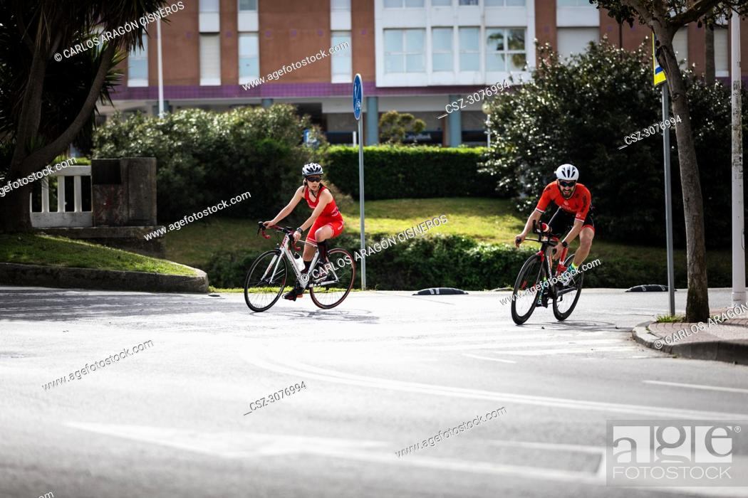 Stock Photo: CASTRO URDIALES, SPAIN - APRIL 22, 2018: Unidentified athlete in the cycling competition during the III Duathlon Triflavi of Castro Urdiales.