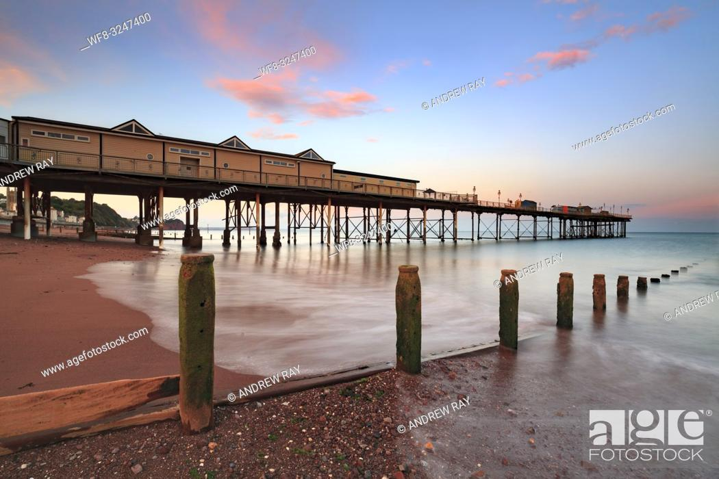 Stock Photo: The Grand Pier at Teignmouth on the south coast of Devon captured at sunset.